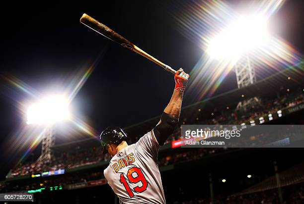 Chris Davis of the Baltimore Orioles warms up in the batters box in the first inning of a game against the Boston Red Sox at Fenway Park on September...