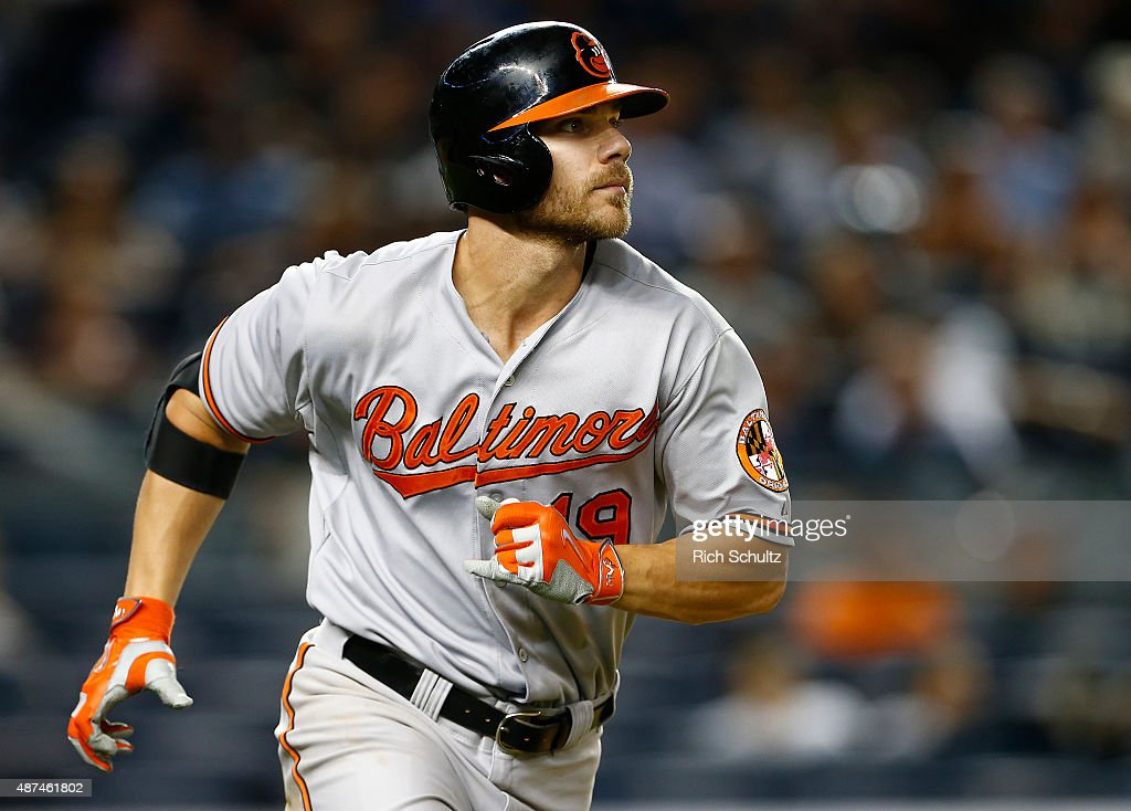 Chris Davis #19 of the Baltimore Orioles watches as he hits an RBI ground rule double in the ninth inning against the New York Yankees in a MLB baseball game at Yankee Stadium on September 9, 2015 in the Bronx borough of New York City. The Orioles defeated the Yankees 5-3.