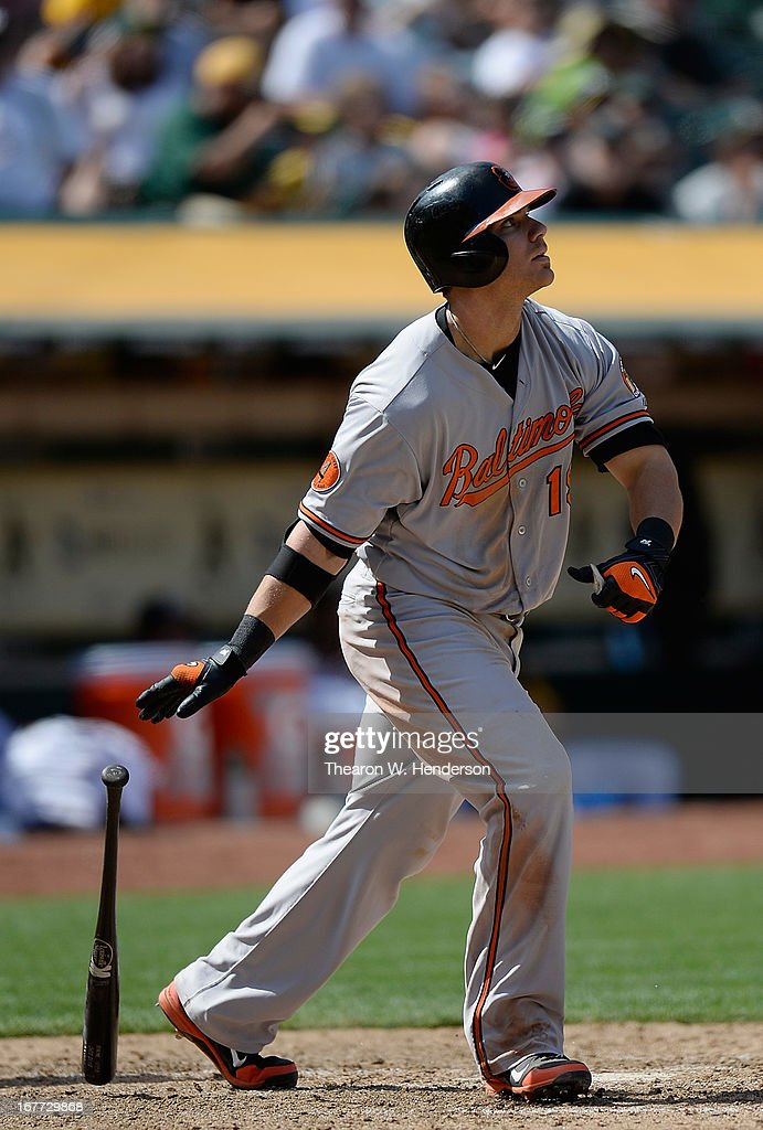 Chris Davis #19 of the Baltimore Orioles watches the flight of his ball as he hits a solo home run the that put the Orioles ahead of the Oakland Athletics 7-6 in the eighth inning at O.co Coliseum on April 28, 2013 in Oakland, California.