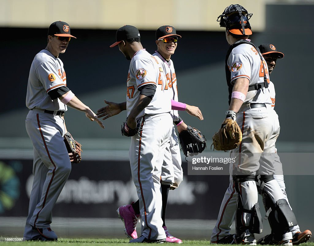 Chris Davis #19, Pedro Strop #47, <a gi-track='captionPersonalityLinkClicked' href=/galleries/search?phrase=Manny+Machado&family=editorial&specificpeople=5591039 ng-click='$event.stopPropagation()'>Manny Machado</a> #13, <a gi-track='captionPersonalityLinkClicked' href=/galleries/search?phrase=Chris+Snyder&family=editorial&specificpeople=201238 ng-click='$event.stopPropagation()'>Chris Snyder</a> #48 and <a gi-track='captionPersonalityLinkClicked' href=/galleries/search?phrase=Alexi+Casilla&family=editorial&specificpeople=4180372 ng-click='$event.stopPropagation()'>Alexi Casilla</a> #12 of the Baltimore Orioles celebrate a win of the game against the Minnesota Twins on May 12, 2013 at Target Field in Minneapolis, Minnesota. The Orioles defeated the Twins 6-0.