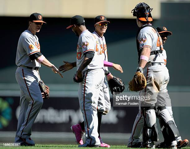 Chris Davis Pedro Strop Manny Machado Chris Snyder and Alexi Casilla of the Baltimore Orioles celebrate a win of the game against the Minnesota Twins...
