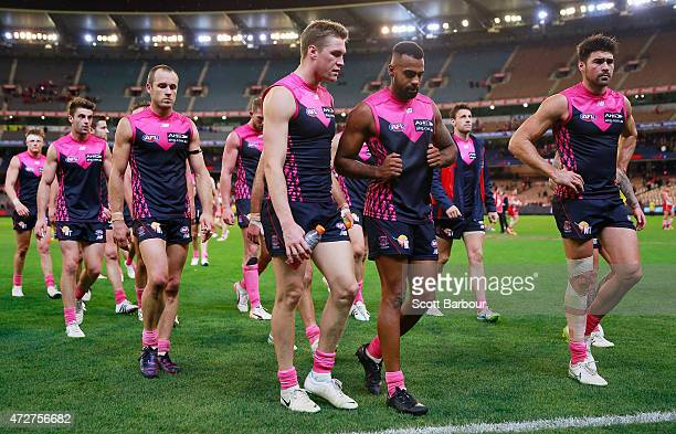 Chris Dawes and the Demons leave the field after losing the round six AFL match between the Melbourne Demons and the Sydney Swans at Melbourne...