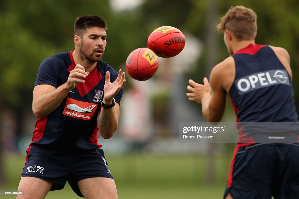 Chris Dawes handballs during a Melbourne Demons AFL pre-season training session at Gosch's Paddock on November 26, 2012 in Melbourne, Australia.