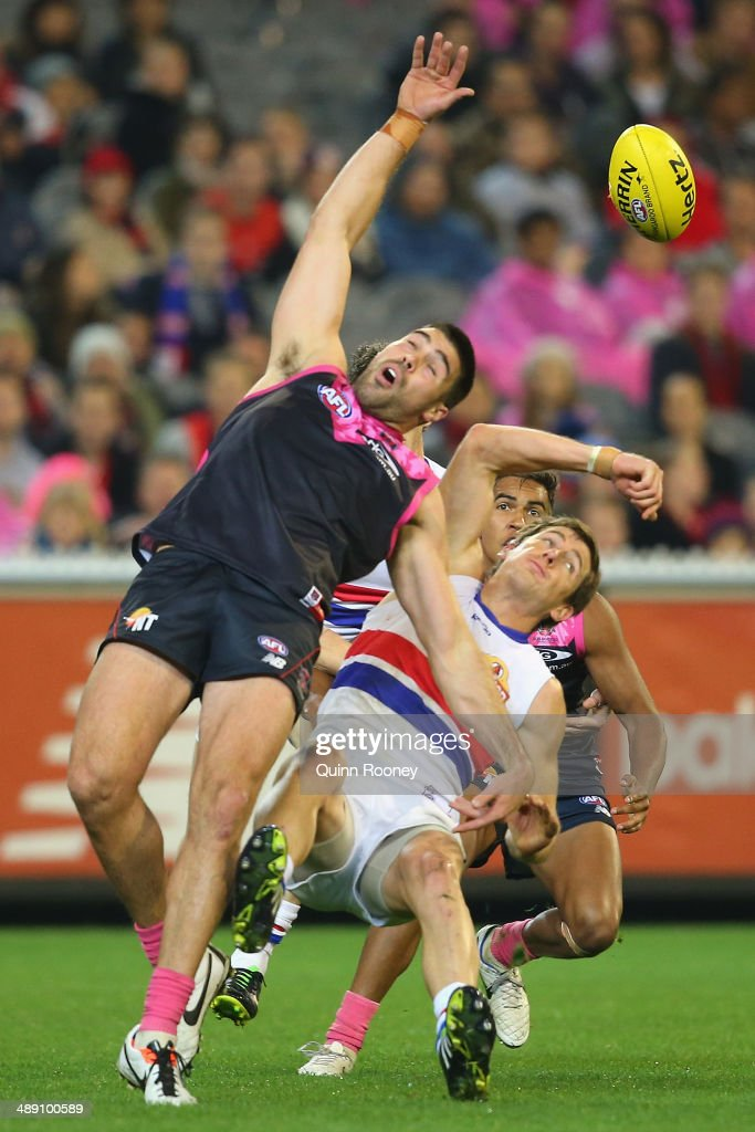 Chris Dawes of the Demons and Dale Morris of the Bulldogs contest for a mark during the round eight AFL match between the Melbourne Demons and the Western Bulldogs at Melbourne Cricket Ground on May 10, 2014 in Melbourne, Australia.