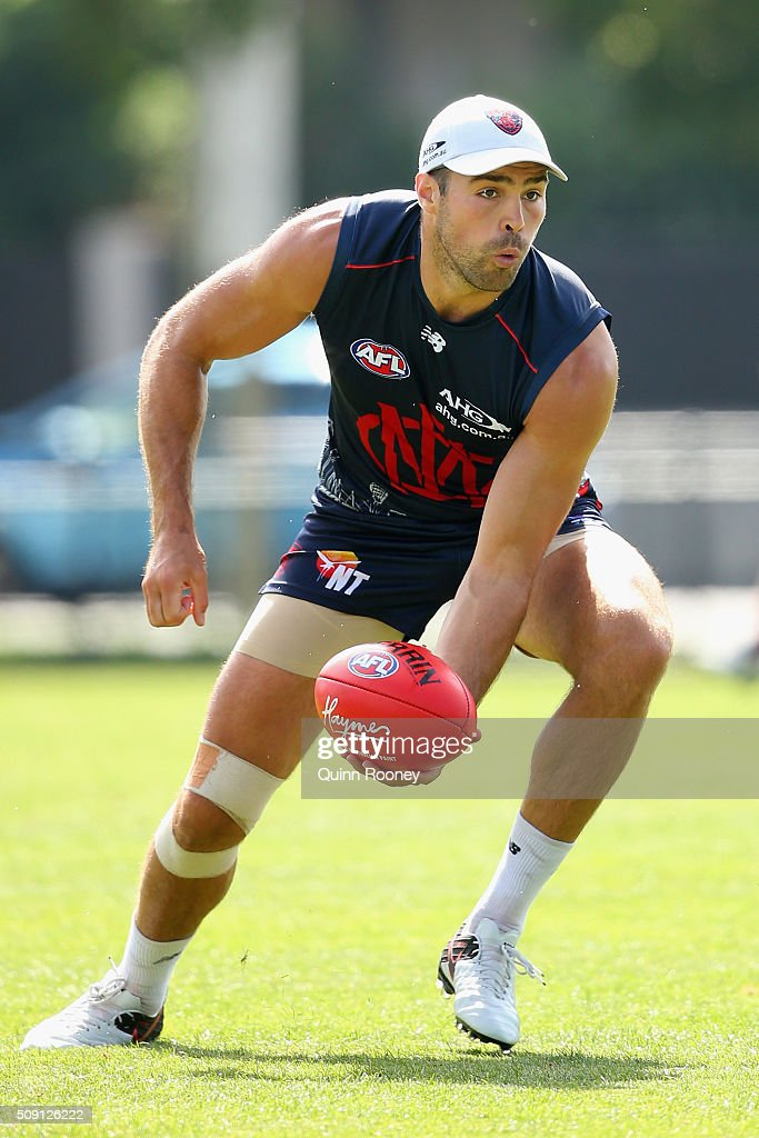 Chris Dawes of the Demons handballs during a Melbourne Demons AFL pre-season training session at Gosch's Paddock on February 9, 2016 in Melbourne, Australia.