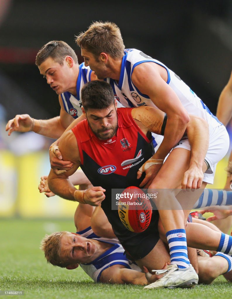 Chris Dawes of the Demons is tackled during the round 18 AFL match between the Melbourne Demons and the North Melbourne Kangaroos at Etihad Stadium on July 27, 2013 in Melbourne, Australia.