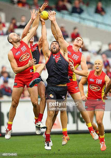 Chris Dawes of the Demons marks infront of Matthew Warnock of the Suns during the round five AFL match between the Melbourne Demons and the Gold...