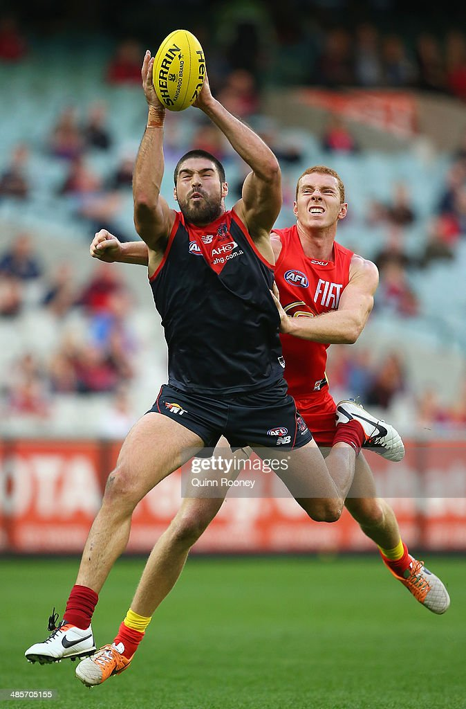 Chris Dawes of the Demons marks infront of Rory Thompson of the Suns during the round five AFL match between the Melbourne Demons and the Gold Coast Suns at Melbourne Cricket Ground on April 20, 2014 in Melbourne, Australia.