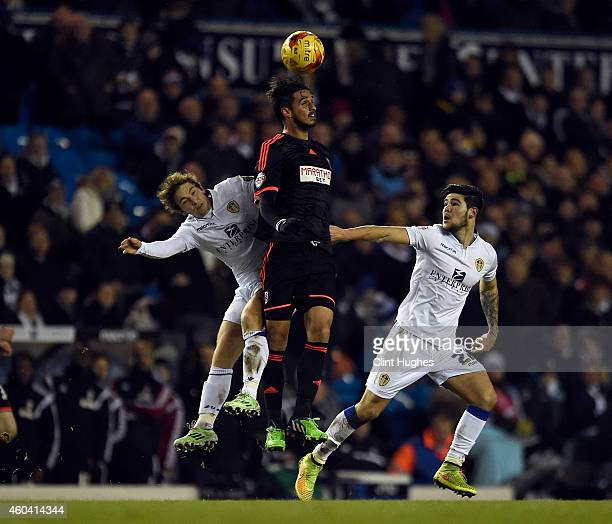 Chris Dawson of Leeds United and Bryan Ruiz of Fulham contest a header during the Sky Bet Championship match between Leeds United and Fulham at...