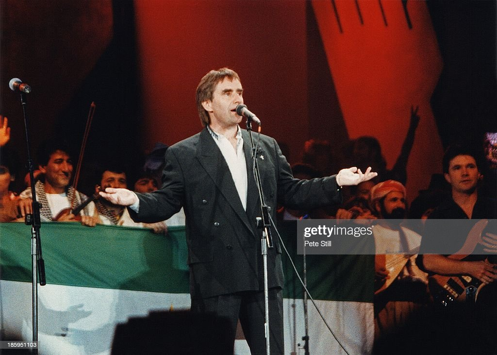 Chris De Burgh performs on stage at 'The Simple Truth' concert at Wembley Arena, in aid of Kurdish Refugees, on May 12th, 1991 in London, England.