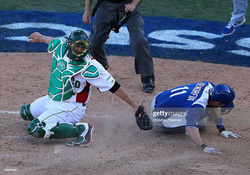 <a gi-track='captionPersonalityLinkClicked' href=/galleries/search?phrase=Chris+Denorfia&family=editorial&specificpeople=702417 ng-click='$event.stopPropagation()'>Chris Denorfia</a> #11 of Italy slides past the tag from catcher <a gi-track='captionPersonalityLinkClicked' href=/galleries/search?phrase=Humberto+Cota&family=editorial&specificpeople=587443 ng-click='$event.stopPropagation()'>Humberto Cota</a> #24 of Mexico to score the go ahead run during the ninth inning of the World Baseball Classic First Round Group D game at Salt River Fields at Talking Stick on March 7, 2013 in Scottsdale, Arizona. Italy defeated Mexico 6-5.