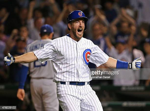 Chris Denorfia of the Chicago Cubs celebrates after hitting a sacrific fly to drive in a run to defeat the Los Angeles Dodgers at Wrigley Field on...