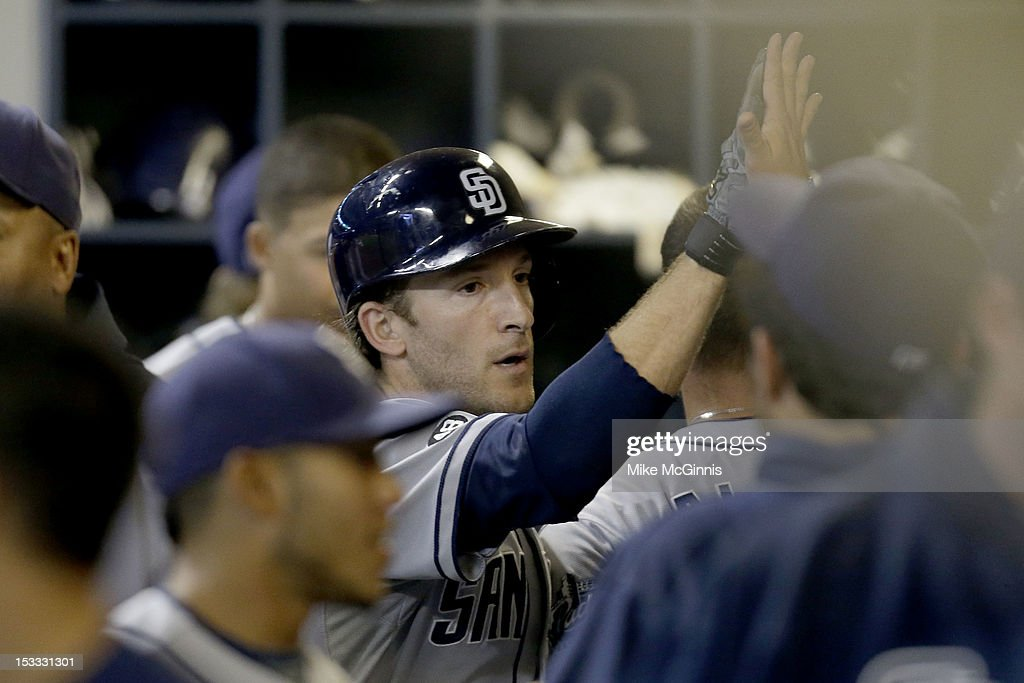 <a gi-track='captionPersonalityLinkClicked' href=/galleries/search?phrase=Chris+Denorfia&family=editorial&specificpeople=702417 ng-click='$event.stopPropagation()'>Chris Denorfia</a> #13 of the San Diego Padres celebrates in the dugout after hitting a solo home run in the top of the fourth inning against the Milwaukee Brewers at Miller Park on October 3, 2012 in Milwaukee, Wisconsin.