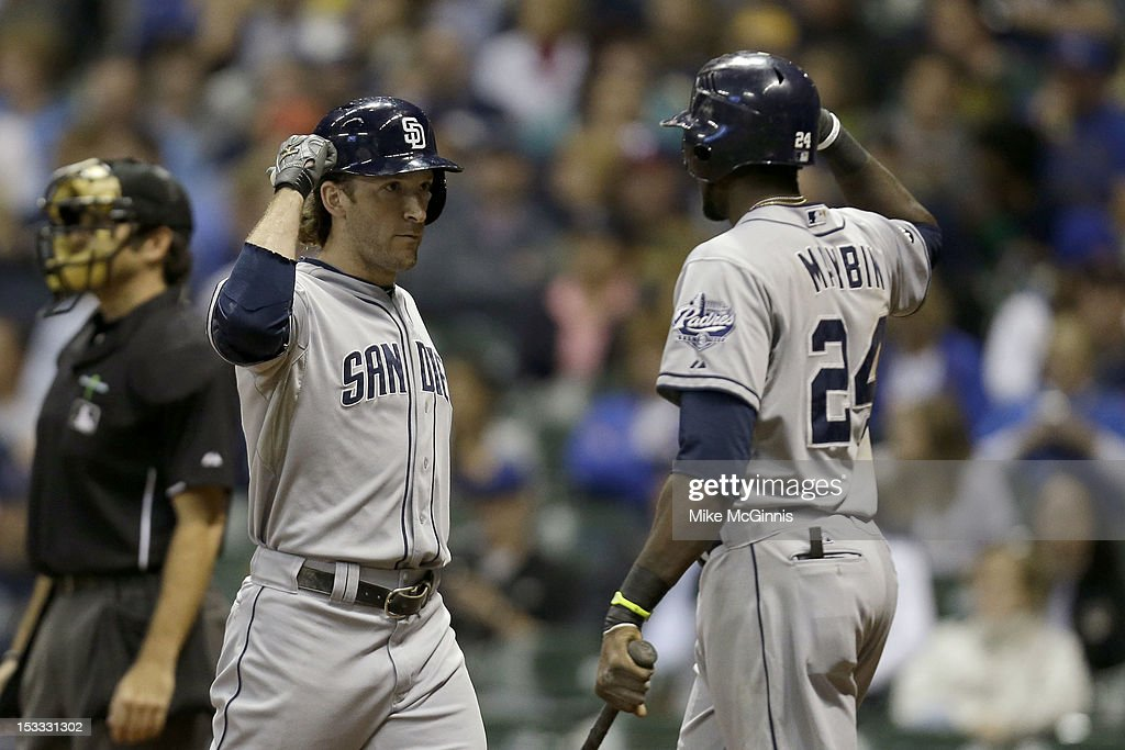 <a gi-track='captionPersonalityLinkClicked' href=/galleries/search?phrase=Chris+Denorfia&family=editorial&specificpeople=702417 ng-click='$event.stopPropagation()'>Chris Denorfia</a> #13 of the San Diego Padres celebrates with <a gi-track='captionPersonalityLinkClicked' href=/galleries/search?phrase=Cameron+Maybin&family=editorial&specificpeople=2364846 ng-click='$event.stopPropagation()'>Cameron Maybin</a> #24 after hitting a solo home run in the top of the fourth inning against the Milwaukee Brewers at Miller Park on October 3, 2012 in Milwaukee, Wisconsin.