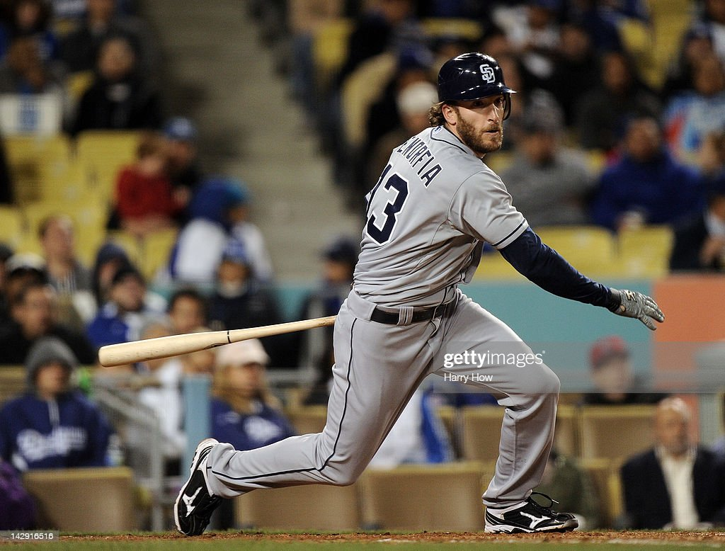 <a gi-track='captionPersonalityLinkClicked' href=/galleries/search?phrase=Chris+Denorfia&family=editorial&specificpeople=702417 ng-click='$event.stopPropagation()'>Chris Denorfia</a> #13 of the San Diego Padres doubles in a run in the seventh inning to trail 8-4 to the Los Angeles Dodgers at Dodger Stadium on April 13, 2012 in Los Angeles, California.
