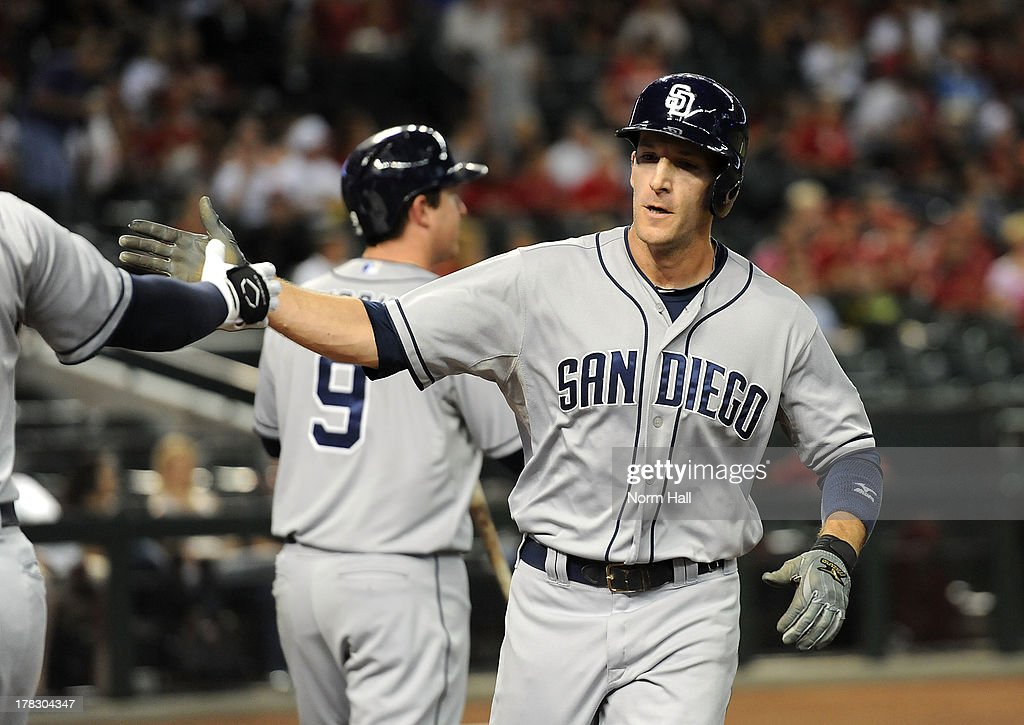 <a gi-track='captionPersonalityLinkClicked' href=/galleries/search?phrase=Chris+Denorfia&family=editorial&specificpeople=702417 ng-click='$event.stopPropagation()'>Chris Denorfia</a> #13 of the San Diego Padres high fives a teammate after scoring against the Arizona Diamondbacks at Chase Field on August 28, 2013 in Phoenix, Arizona.