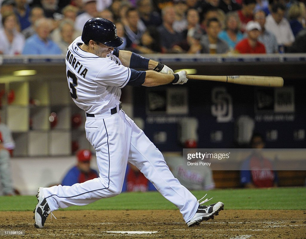 Chris Denorfia #13 of the San Diego Padres hits a two-run homer during the fifth inning of a baseball game against the Philadelphia Phillies at Petco Park on June 26, 2013 in San Diego, California.