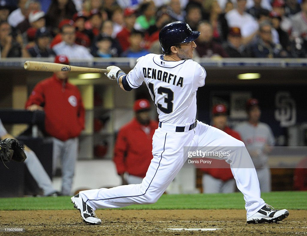<a gi-track='captionPersonalityLinkClicked' href=/galleries/search?phrase=Chris+Denorfia&family=editorial&specificpeople=702417 ng-click='$event.stopPropagation()'>Chris Denorfia</a> #13 of the San Diego Padres hits a walk-off two run homer during the ninth inning of a baseball game against the Cincinnati Reds at Petco Park on July 29, 2013 in San Diego, California. The Padres won 2-1.