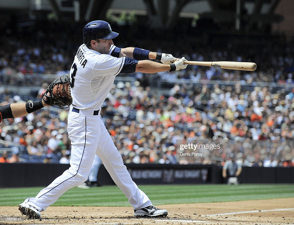 <a gi-track='captionPersonalityLinkClicked' href=/galleries/search?phrase=Chris+Denorfia&family=editorial&specificpeople=702417 ng-click='$event.stopPropagation()'>Chris Denorfia</a> #13 of the San Diego Padres hits an RBI single during the second inning of a baseball game against the San Francisco Giants at Petco Park on September 2, 2013 in San Diego, California.