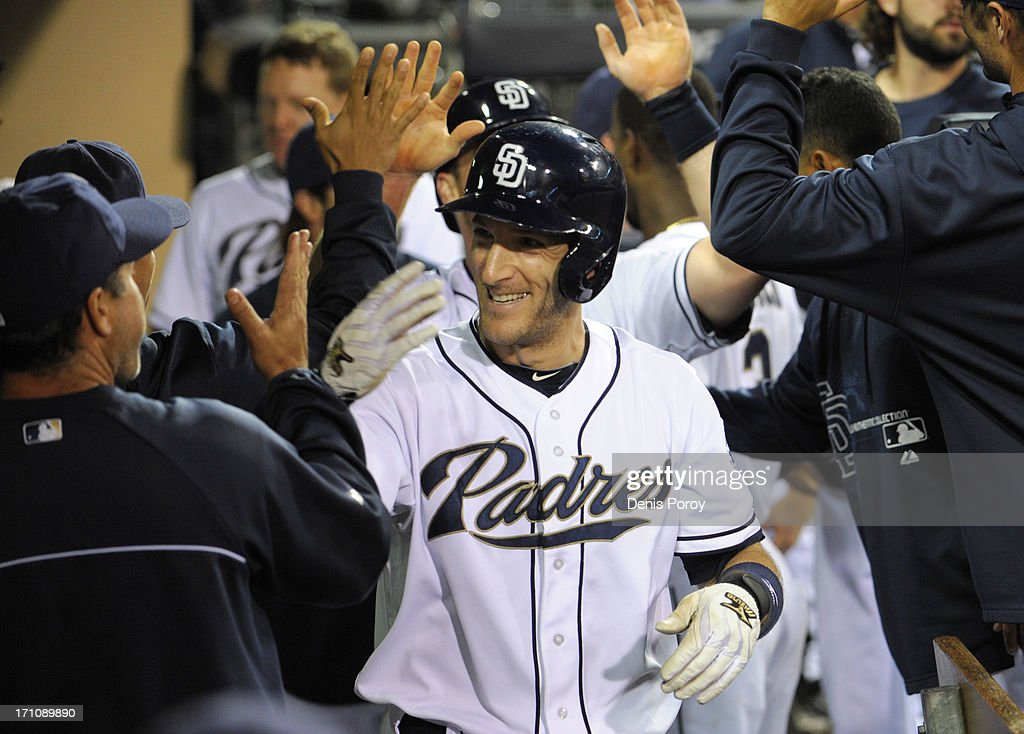 <a gi-track='captionPersonalityLinkClicked' href=/galleries/search?phrase=Chris+Denorfia&family=editorial&specificpeople=702417 ng-click='$event.stopPropagation()'>Chris Denorfia</a> #13 of the San Diego Padres is congratulated after scoring during the third inning of a baseball game against the Los Angeles Dodgers at Petco Park on June 21, 2013 in San Diego, California.