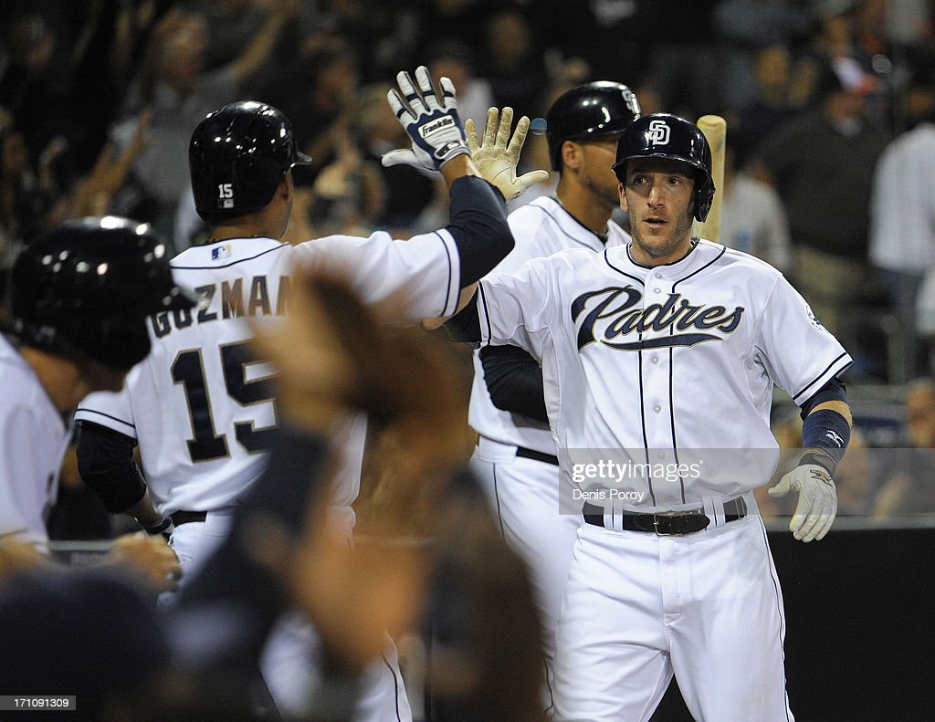 <a gi-track='captionPersonalityLinkClicked' href=/galleries/search?phrase=Chris+Denorfia&family=editorial&specificpeople=702417 ng-click='$event.stopPropagation()'>Chris Denorfia</a> #13 of the San Diego Padres is congratulated by Jesus Guzman #15 after scoring during the third inning of a baseball game against the Los Angeles Dodgers at Petco Park on June 21, 2013 in San Diego, California. The Padres won 5-2.
