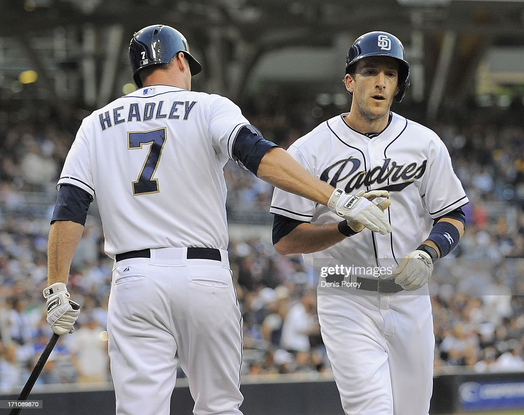 Chris Denorfia #13 of the San Diego Padres is congratulated by teammate Chase Headley #7 after hitting a solo home run during the first inning of a baseball game against the Los Angeles Dodgers at Petco Park on June 21, 2013 in San Diego, California.