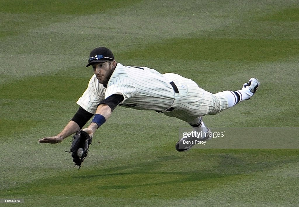 Chris Denorfia #13 of the San Diego Padres makes a diving catch on a ball hit by Jayson Werth #28 of the Washington Nationals during the eighth inning of a baseball game at Petco Park on June 11, 2011 in San Diego, California.