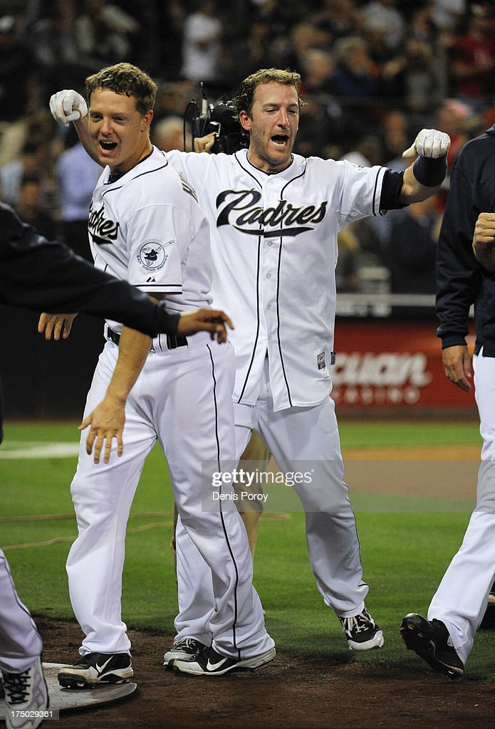 <a gi-track='captionPersonalityLinkClicked' href=/galleries/search?phrase=Chris+Denorfia&family=editorial&specificpeople=702417 ng-click='$event.stopPropagation()'>Chris Denorfia</a> #13 of the San Diego Padres, right, celebrates next to <a gi-track='captionPersonalityLinkClicked' href=/galleries/search?phrase=Nick+Hundley&family=editorial&specificpeople=4175399 ng-click='$event.stopPropagation()'>Nick Hundley</a> #4 after he hit a walk-off two run homer during the ninth inning of a baseball game against the Cincinnati Reds at Petco Park on July 29, 2013 in San Diego, California. The Padres won 2-1.