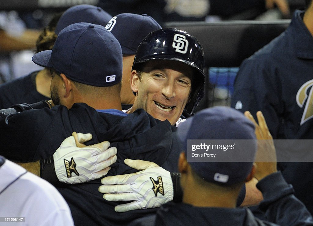 <a gi-track='captionPersonalityLinkClicked' href=/galleries/search?phrase=Chris+Denorfia&family=editorial&specificpeople=702417 ng-click='$event.stopPropagation()'>Chris Denorfia</a> #13 of the San Diego Padres, right, hugs <a gi-track='captionPersonalityLinkClicked' href=/galleries/search?phrase=Yonder+Alonso&family=editorial&specificpeople=4424898 ng-click='$event.stopPropagation()'>Yonder Alonso</a> #23 after Denorfia hit a two-run homer during the fifth inning of a baseball game against the Philadelphia Phillies at Petco Park on June 26, 2013 in San Diego, California.