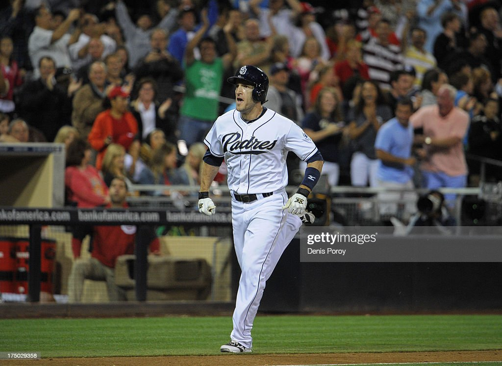 <a gi-track='captionPersonalityLinkClicked' href=/galleries/search?phrase=Chris+Denorfia&family=editorial&specificpeople=702417 ng-click='$event.stopPropagation()'>Chris Denorfia</a> #13 of the San Diego Padres rounds the bases after he hit a walk-off two run homer during the ninth inning of a baseball game against the Cincinnati Reds at Petco Park on July 29, 2013 in San Diego, California. The Padres won 2-1.