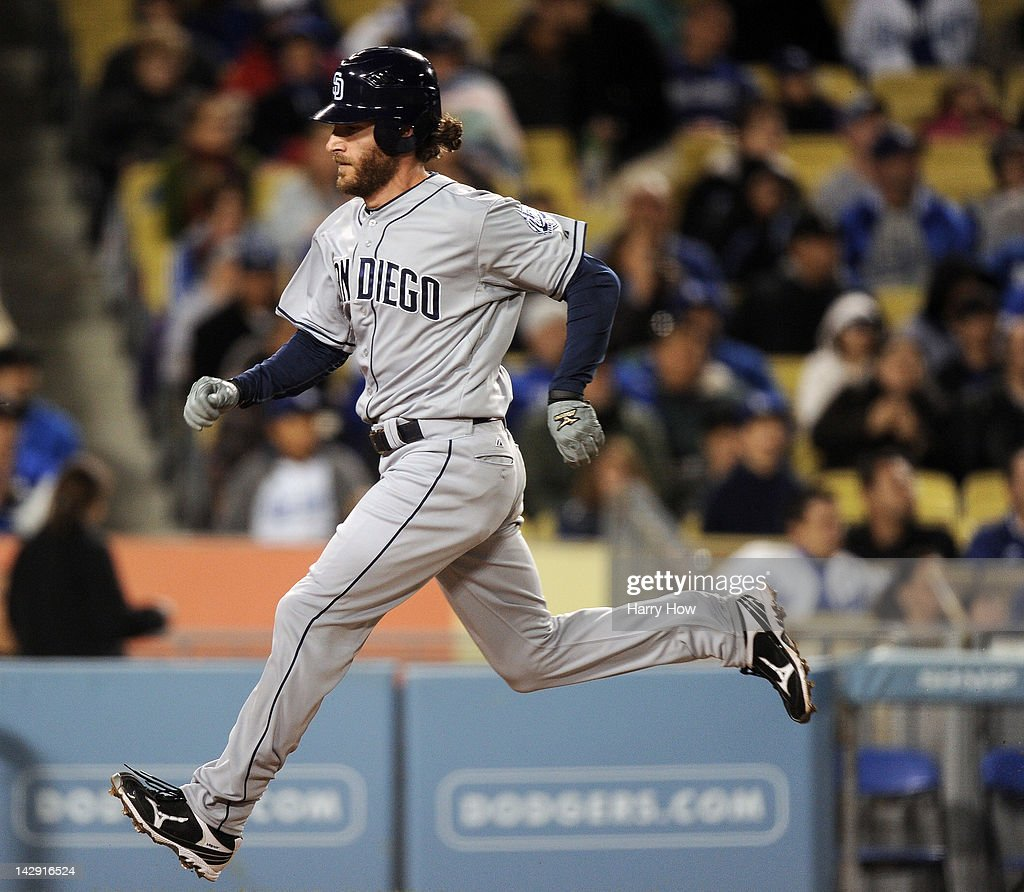 <a gi-track='captionPersonalityLinkClicked' href=/galleries/search?phrase=Chris+Denorfia&family=editorial&specificpeople=702417 ng-click='$event.stopPropagation()'>Chris Denorfia</a> #13 of the San Diego Padres scores a run on a sacrifce fly by Chase Headley #7 to trail 8-6 to the Los Angeles Dodgers during the seventh inning at Dodger Stadium on April 13, 2012 in Los Angeles, California.
