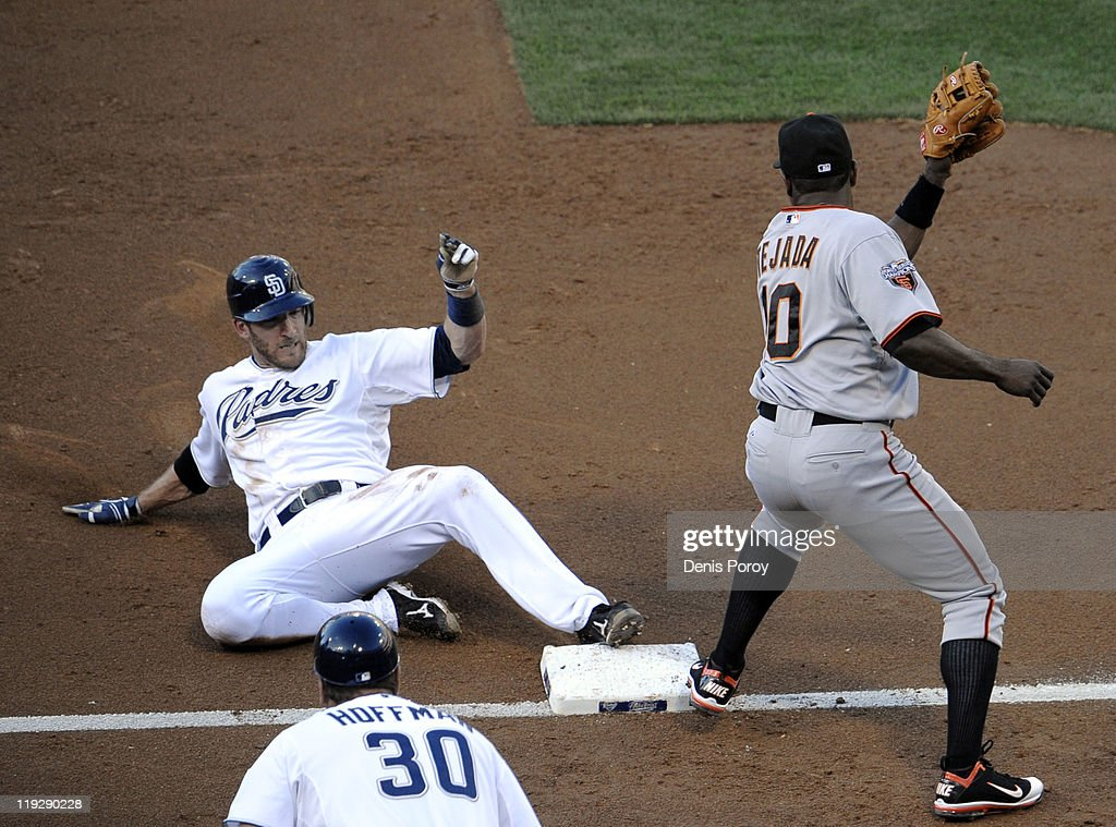 <a gi-track='captionPersonalityLinkClicked' href=/galleries/search?phrase=Chris+Denorfia&family=editorial&specificpeople=702417 ng-click='$event.stopPropagation()'>Chris Denorfia</a> #13 of the San Diego Padres slides into third base ahead of the tag of <a gi-track='captionPersonalityLinkClicked' href=/galleries/search?phrase=Miguel+Tejada&family=editorial&specificpeople=202227 ng-click='$event.stopPropagation()'>Miguel Tejada</a> #10 of the San Francisco Giants during the third inning of a baseball game at Petco Park on July 16, 2011 in San Diego, California.