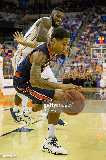 Chris Denson of the Auburn Tigers is defended by Patric Young of the Florida Gators during the first half of the game at the Stephen C O'Connell...