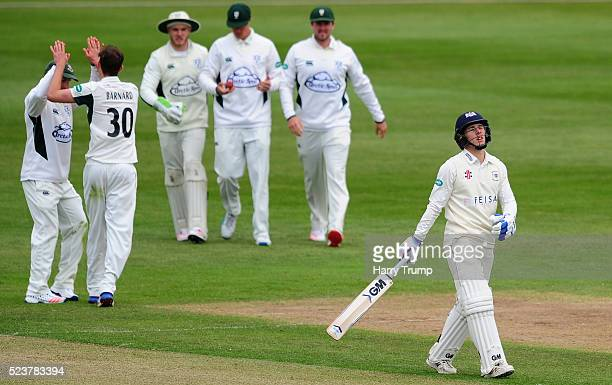 Chris Dent of Gloucestershire reacts after being dismissed during Day One of the Specsavers County Championship Division Two match between...
