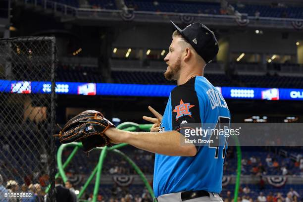 Chris Devenski of the Houston Astros and the American League warms up during batting practice for the 88th MLB AllStar Game at Marlins Park on July...