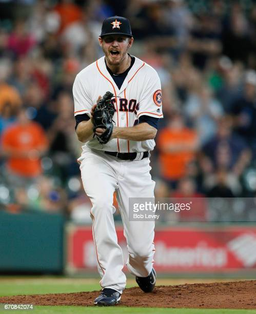 Chris Devenski of the Houston Astros celebrates after striking out Danny Espinosa of the Los Angeles Angels of Anaheim to end the game at Minute Maid...