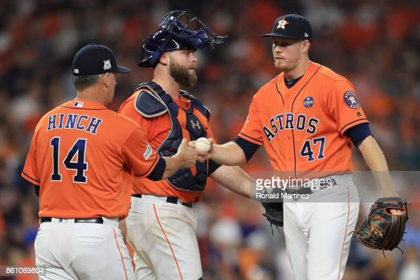 Chris Devenski of the Houston Astros is pulled from the game in the eighth inning by manager AJ Hinch during game one of the American League...