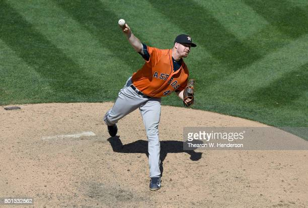 Chris Devenski of the Houston Astros pitches against the Oakland Athletics in the bottom of the ninth inning at Oakland Alameda Coliseum on June 22...