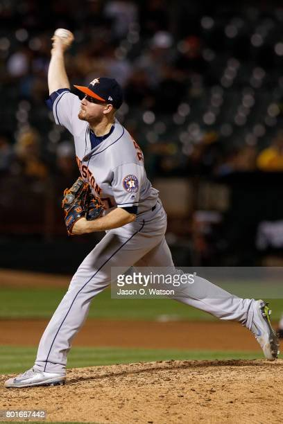 Chris Devenski of the Houston Astros pitches against the Oakland Athletics during the eighth inning at the Oakland Coliseum on June 19 2017 in...