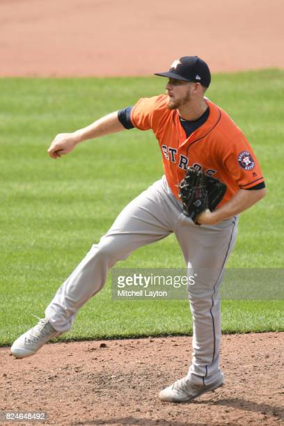 Chris Devenski of the Houston Astros pitches during a baseball game against the Baltimore Orioles at Oriole Park at Camden Yards on July 23 2017 in...