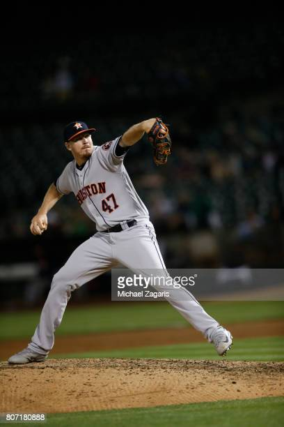 Chris Devenski of the Houston Astros pitches during the game against the Oakland Athletics at the Oakland Alameda Coliseum on June 19 2017 in Oakland...
