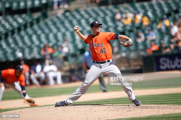Chris Devenski of the Houston Astros pitches during the game against the Oakland Athletics at the Oakland Alameda Coliseum on June 22 2017 in Oakland...