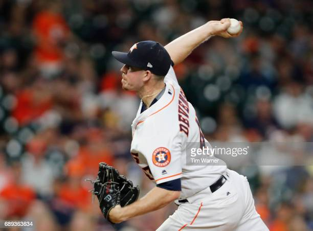 Chris Devenski of the Houston Astros pitches in the eighth inning against the Detroit Tigers at Minute Maid Park on May 24 2017 in Houston Texas