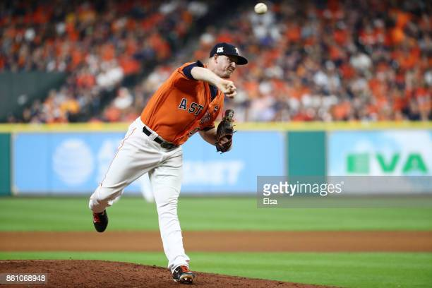 Chris Devenski of the Houston Astros pitches in the eighth inning against the New York Yankees during game one of the American League Championship...