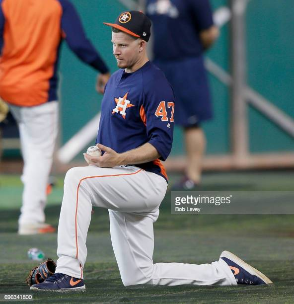 Chris Devenski of the Houston Astros stretches during batting practice at Minute Maid Park on June 12 2017 in Houston Texas
