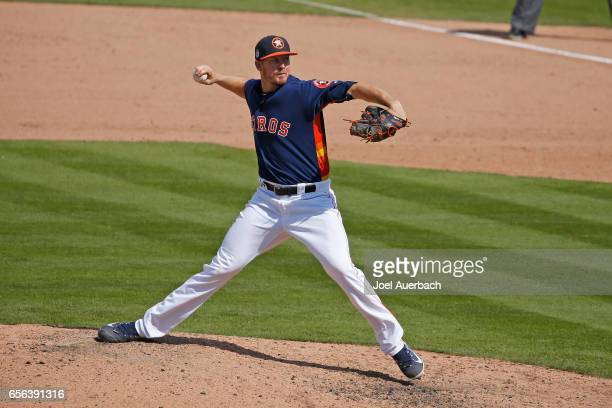 Chris Devenski of the Houston Astros throws the ball against the New York Yankees during a spring training game at The Ballpark of the Palm Beaches...
