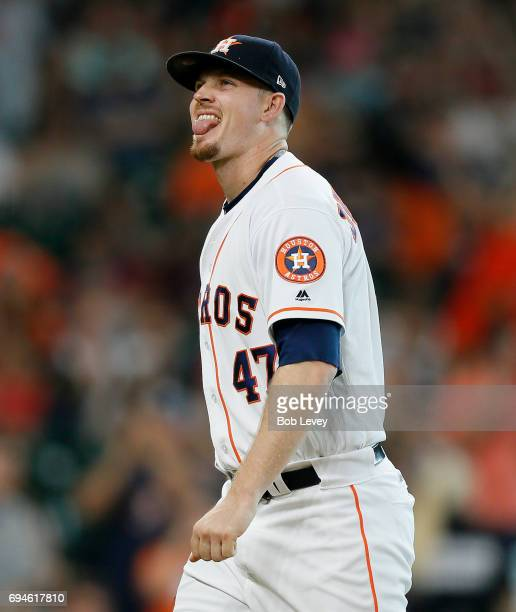 Chris Devenski of the Houston Astros walks off the mound after retiring the side in the eighth inning against the Los Angeles Angels of Anaheim at...