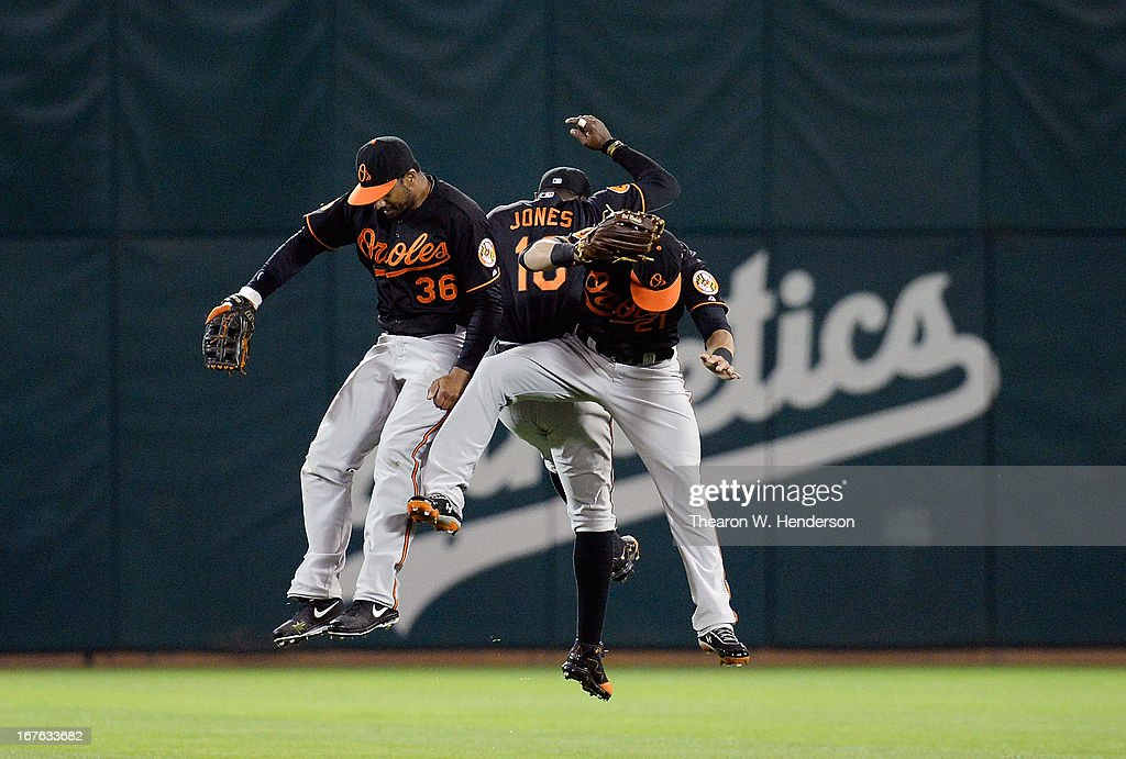Chris Dickerson #36, Adam Jones #10 and <a gi-track='captionPersonalityLinkClicked' href=/galleries/search?phrase=Nick+Markakis&family=editorial&specificpeople=614708 ng-click='$event.stopPropagation()'>Nick Markakis</a> #21 of the Baltimore Orioles celebrate after defeating the Oakland Athletics 3-0 at O.co Coliseum on April 26, 2013 in Oakland, California.