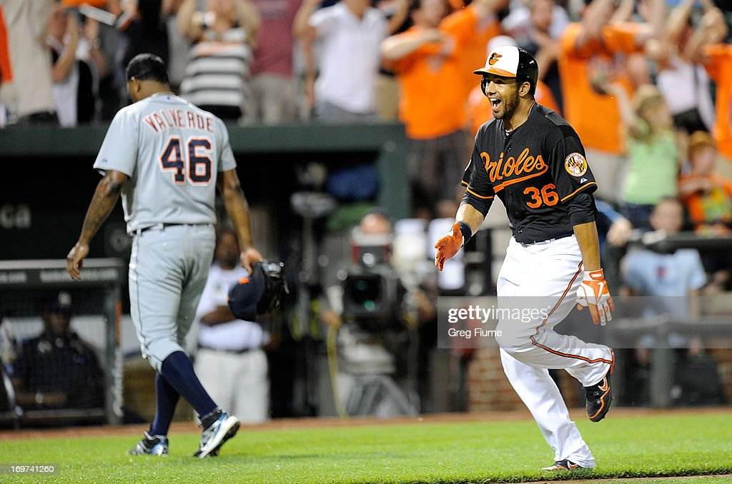 Chris Dickerson #36 of the Baltimore Orioles celebrates after hitting the game winning home run in the ninth inning against the Detroit Tigers at Oriole Park at Camden Yards on May 31, 2013 in Baltimore, Maryland. Baltimore won the game 7-5.