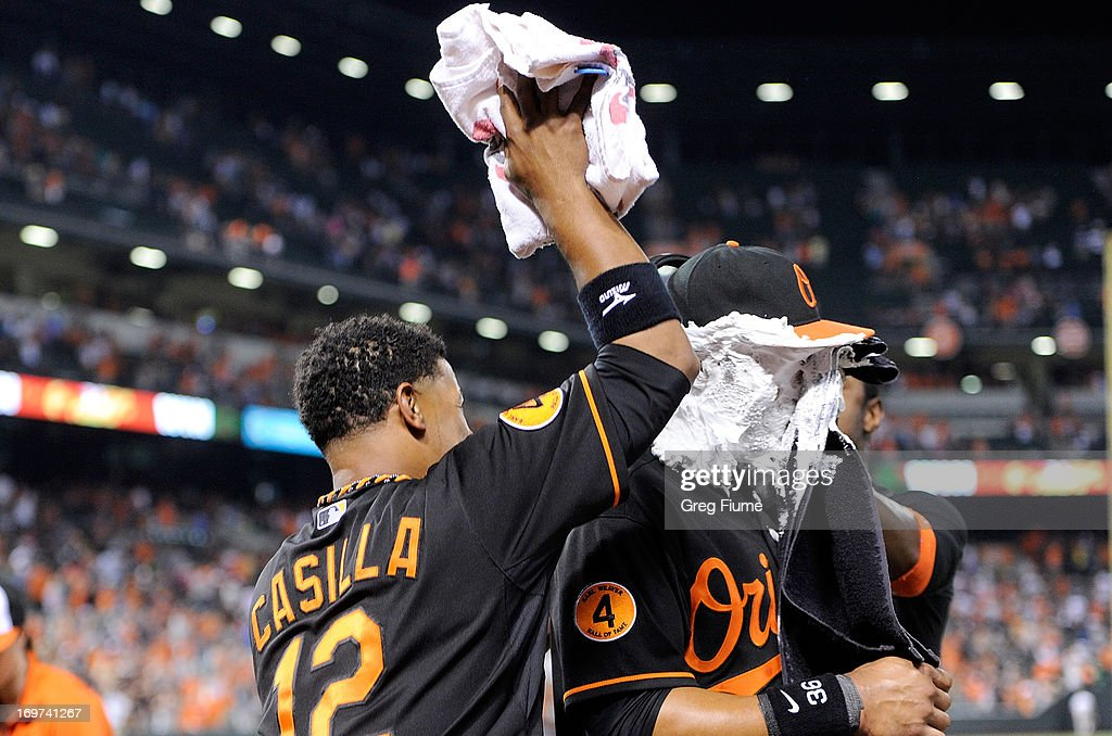 Chris Dickerson #36 of the Baltimore Orioles gets shaving creamed by <a gi-track='captionPersonalityLinkClicked' href=/galleries/search?phrase=Alexi+Casilla&family=editorial&specificpeople=4180372 ng-click='$event.stopPropagation()'>Alexi Casilla</a> #12 and Adam Jones #10 after hitting the game winning home run in the ninth inning against the Detroit Tigers at Oriole Park at Camden Yards on May 31, 2013 in Baltimore, Maryland. Baltimore won the game 7-5.
